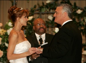Evanka and her husband Joey holding hand and exchanging wedding vows.