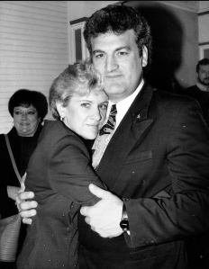 Joey and his ex-wife Mary Jo hugging each other.