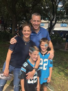 Jerry with his wife and two son hanging out.