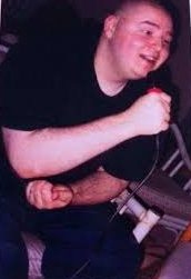 Kevin in his early years before getting tattoos all over his body