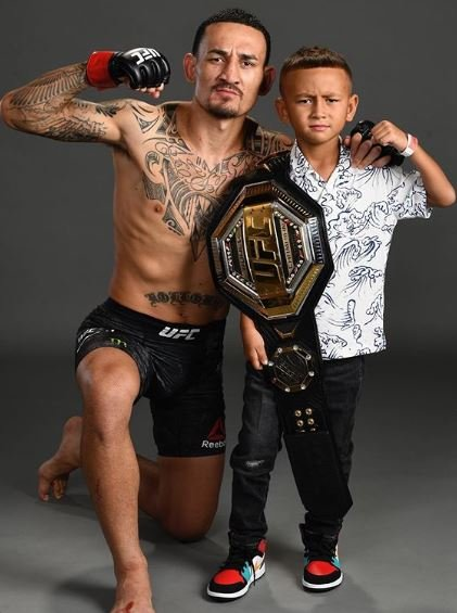 Max Holloway with his son Rush
