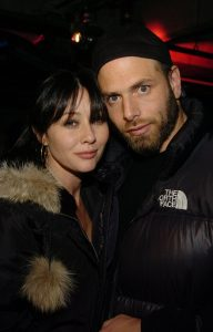 Rick and Shannen taking a picture while attending an even