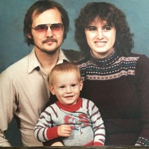 Tyler Hynes with his parents at an early age.