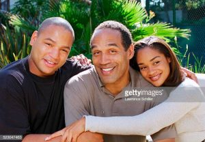 Jason with his father and sister Arnelle enjoying happy period of his life.