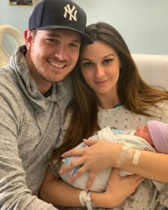 Carter with her husband and newly born baby daughter.