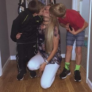 Tasia took a picture with her younger brothers