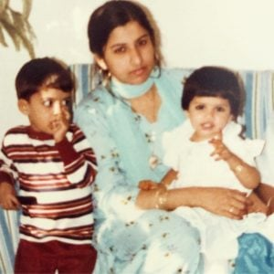 Asifa took a picture during her early years with her mother nad brother