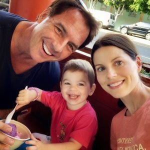 Mark with his wife and daughter Parker Rose took a picture