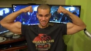 Vegan Gains picture featuring his muscles arm.
