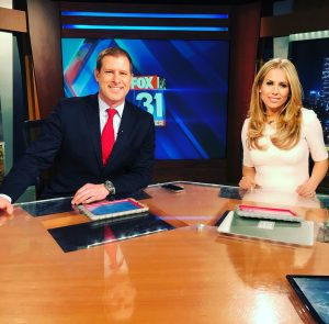 Aristea Brady with her co-anchor.