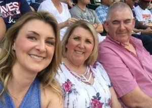Sarah with her parents at Atlanta Braves