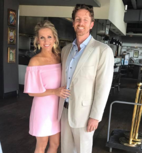 Brady with her husband, Nathan Smith.