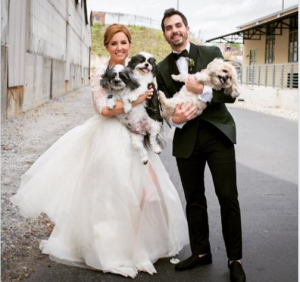 Alex with her husband Elliot and two pets during her wedding.