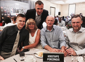 Kristaps Porzingis with his parents and two brothers in a party.