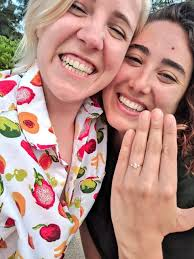 Ella with her fiance, Hannah Hart showing her engagement ring.