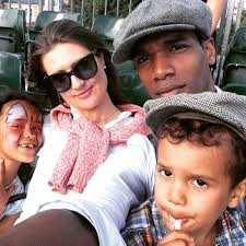Parker Sawyers with his wife and two children.