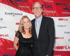 Diana R. Rhoten with her husband John Heilemann.