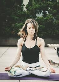 Viviane Thibes practicing yoga.
