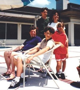 Dave Franco (wearing a red t-shirt) with his father, mother and two older brothers.