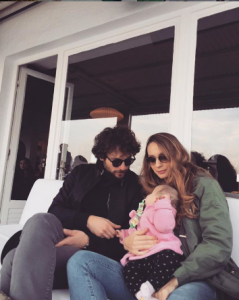 Birkan took a picture with her girlfriend Burcu and his daughter