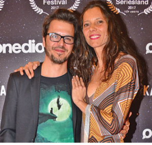 Mehmet and his wife Katerina took a picture duing an event