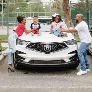 Shanola and Daren with their car, Acura MDX automobile.