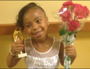 Priah took a picture after winning a contest during her early year