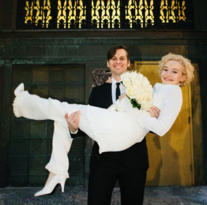 Foster with his beautiful wife, Julia Garner on the wedding day.