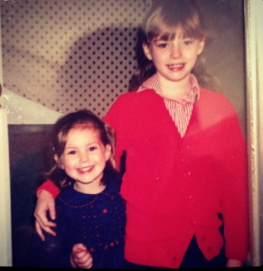 Vanessa took a picture with her sibling during her early years