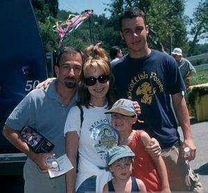 He with his wife, two sons, and step-son, Clay Senechal.