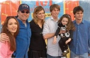 Jason with his three siblings, father, and step-mother.
