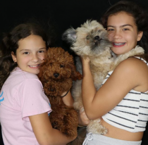 Alisson and Emlly took a picture with their pets Coco and Chanel