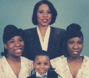 Broderick Harvey Jr with his mother and twin sisters, Kali and Brandi.