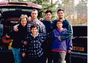 Charlie Cavill with his mother and three older brothers in early teenage.