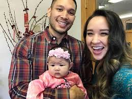 Cathy Nguyen with her husband and daughter
