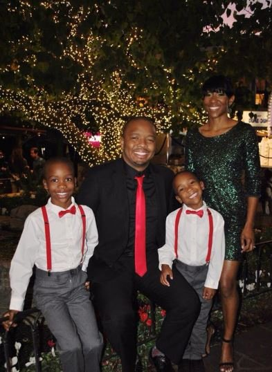 Kevin Fredericks with his wife and children
