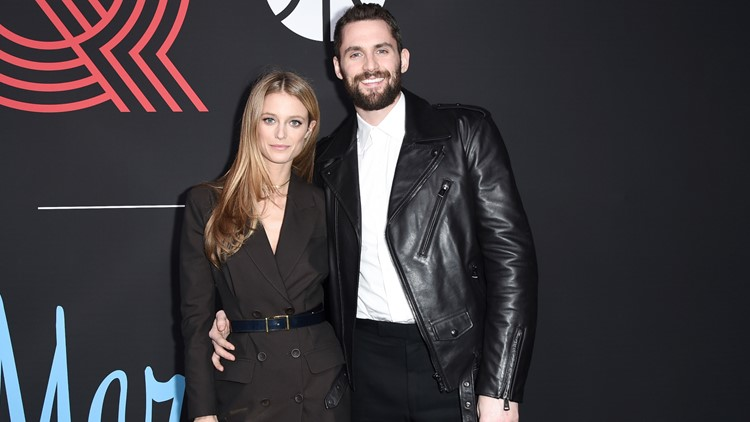 Kevin Love with his partner