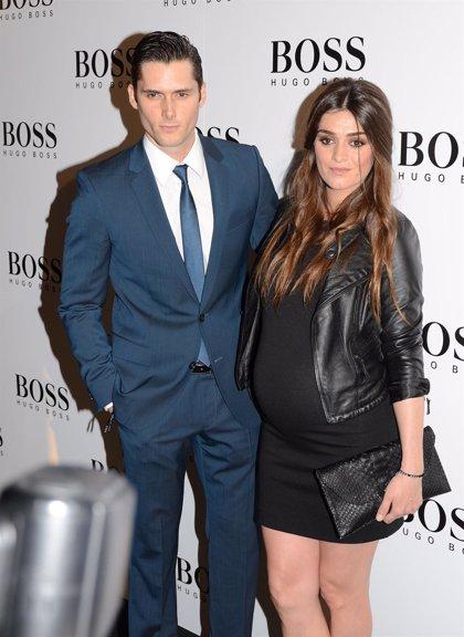 Olivia Molina along with her husband